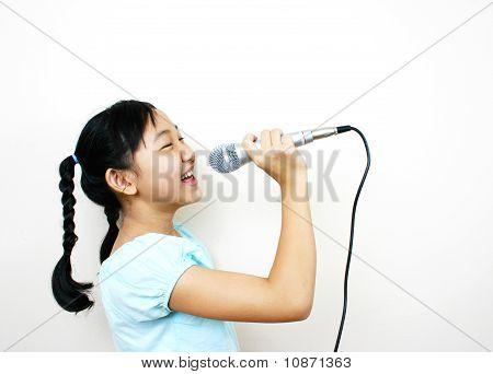 Young asian girl singing.