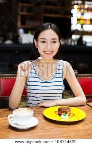 Woman Drinking Coffee And Having Breakfast.