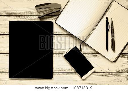 Modern Workplace With Laptop, Pens, Smartphone, Notepad And Stapler On White Wooden Vintage Table Re