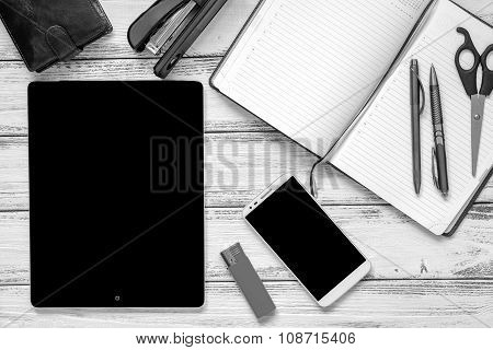 Modern Workplace With Laptop, Golden And Silver Pen, Smartphone, Leather Wallet, Scissors, Lighter,