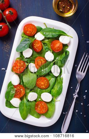 Salad With Cherry Tomatoes, Spinach And Mozarella