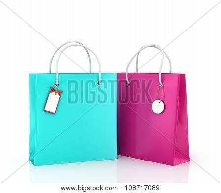 Two Color Bags With Tags On White Background.