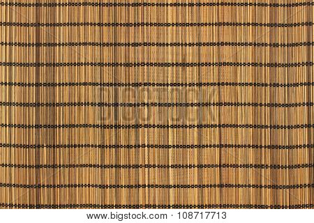 Brown toned bamboo sticks bound with black threads background