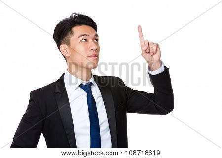 Asian Young Businessman touch on the imaginary button