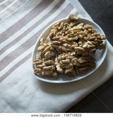 Walnuts On Rustic Wooden Table.