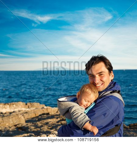 Happy Father with His Little Son in Carrier
