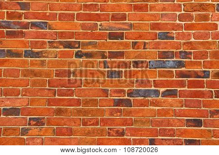 Wall Of Orange Cracked Bricks As Background Or Texture