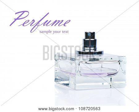 Transparent bottle of pink perfume