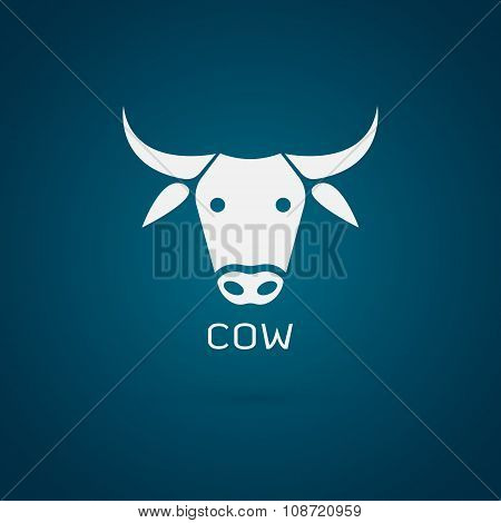 Vector Image Of An Cow Head Design On Blue Background
