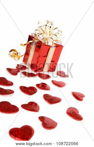 Red gift box and hearts isolated on white