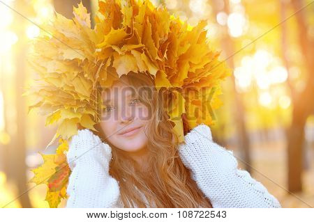 Beautiful Girl In The Autumn Wreath Of Yellow Leaves