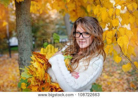 Beautiful Girl With Glasses In Autumn Park