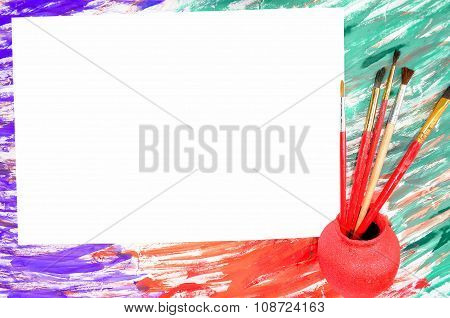 Paper and brushes on an abstract background