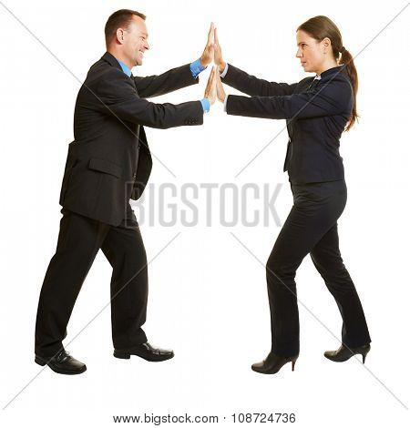 Business man and woman pushing hands against each other