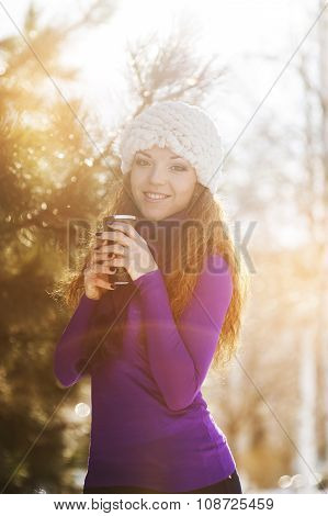Beautiful Happy Girl In The Red Jacket In The Winter.
