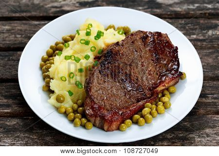 Rare Beef Steak With Mashed Potatoes, Green Peas