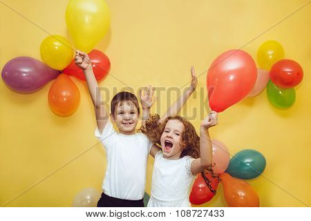Happy children with balloons at happy birthday party.