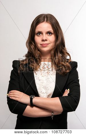 Woman in a business suit on a white background looking at viewer.
