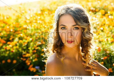 Beautiful Woman on Summer Flowers Background
