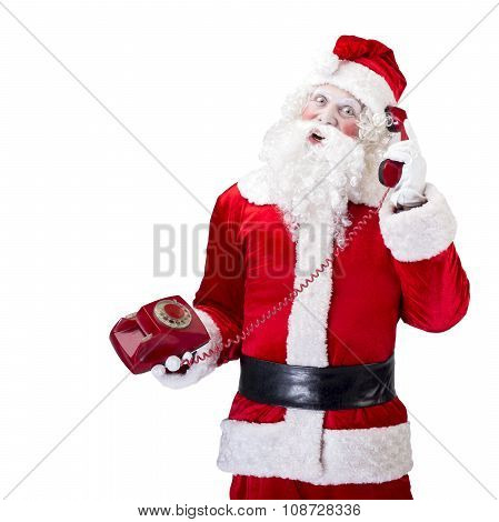 Santa Claus with red telephone posing on white isolated background