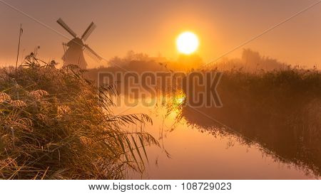 Historic Windmill On A Foggy Morning