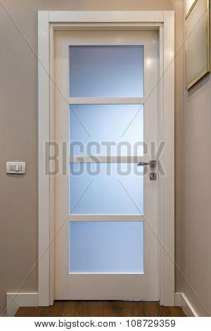 Close up of closed wooden door in the empty room