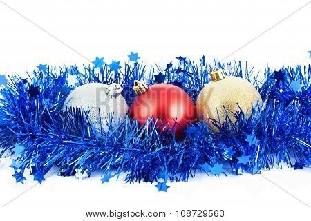 Christmas balls and blue tinsel isolated on white background