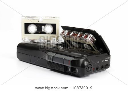Small Cassette Recorder With A Micro Cassette On White Background