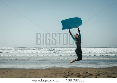 Female Bodyboard Surfer Jumping And Having Fun