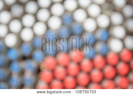 Abstract Blurred Background Of Bottle Caps Arrangement.