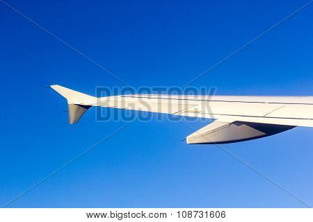 Aircraft Wing Some Component Of Plane On During Flying High Above Sky