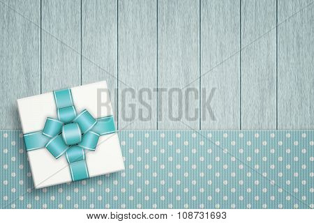 Elegant Gift Lying On Dotted Tablecloth