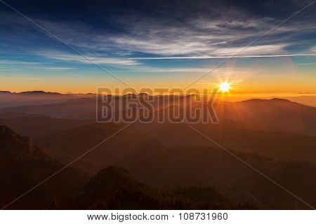 Sunrise Over The Mountain Ridges