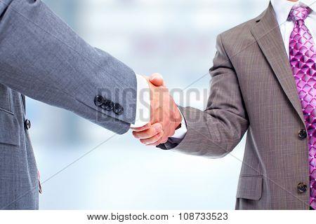 Handshake. Hands of businessman business meeting and teamwork background.