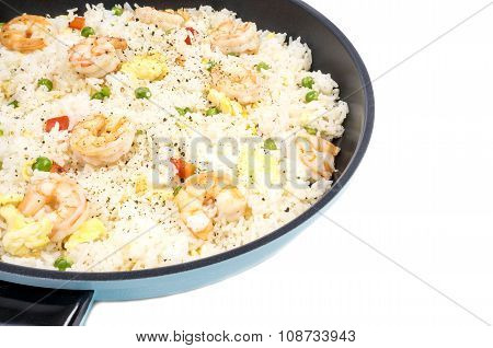 Traditional Chinese Shrimp Fried Rice in a Frying Pan Isolated on White