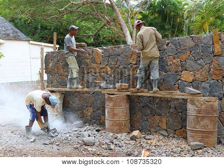 EUREKA, MAURITIUS ISLAND - 30. OCTOBER, 2015: Unidentified African workers build new touristic resort in the rainforest.