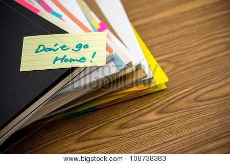 Don't Go Home; The Pile Of Business Documents On The Desk