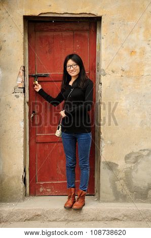 Chinese woman holding lock