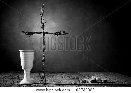 Chalice And Bread On The Wooden Table