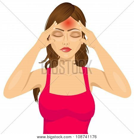 woman touching her temples suffering a headache
