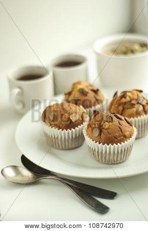 Pumpkin muffins with a plate of pumpkin seeds