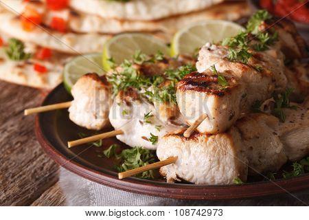 Chicken Tikka Kebabs On Skewers Macro On A Plate. Horizontal