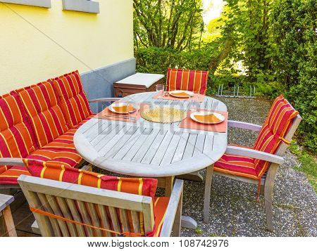 Tableclothes At A Teak Table In The Garden