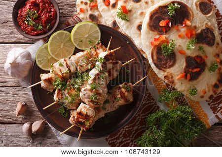 Chicken Tikka On Skewers, Naan Flat Bread Closeup. Horizontal Top View