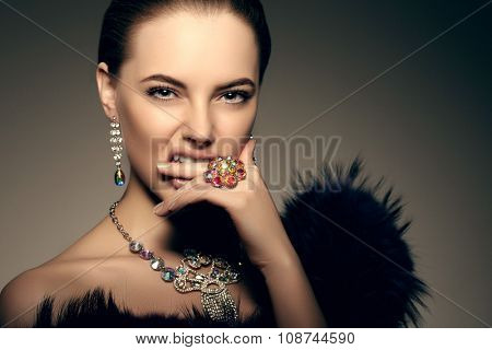 High-fashion Model Beauty Woman precious jewelry Perfect skin lips passion aggression