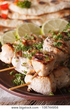 Chicken Tikka Kebabs On Skewers Macro On A Plate. Vertical