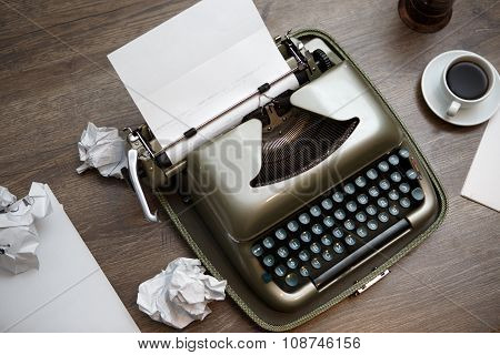 Old typewriter, paper, coffee
