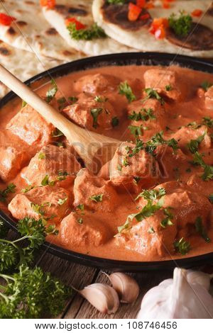 Indian Tikka Masala Chicken Close-up In A Bowl. Vertical