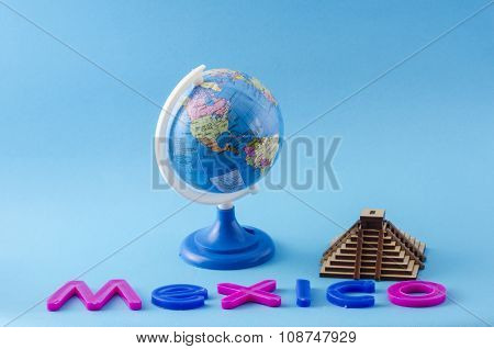 Globe, pyramid and letters