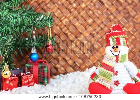 Snowman With The Snow In Wicker Background